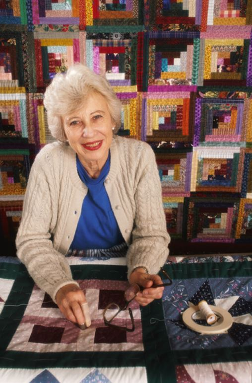 Woman Surrounded by Quilts